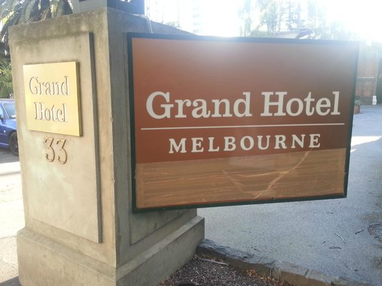 Quest Grand Hotel Melbourne: Front sign, notice the taping below. Needs to be fixed.