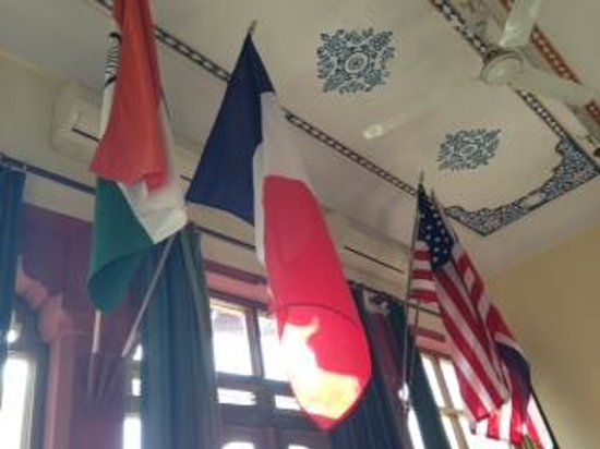 Devi Niketan Heritage Hotel:                   flags in the Dining Area