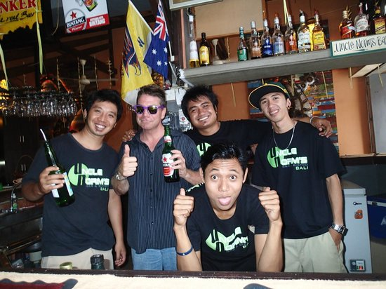 Uncle Norm's Bar & Bistro: My husband with the staff of Uncle Norm's Bar