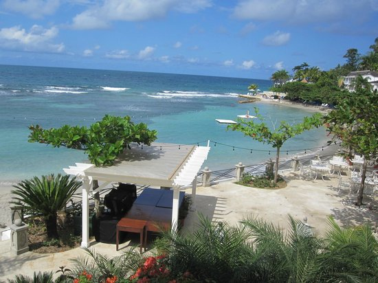 Round Hill Hotel & Villas:                   Partial view of beach, cove, reef