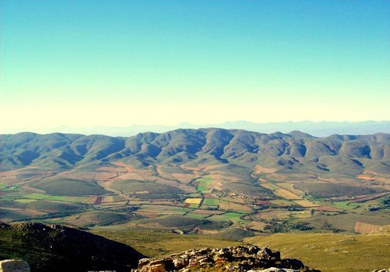 View from the Swartberg Mountains to the Swartberg Country Manor Farm
