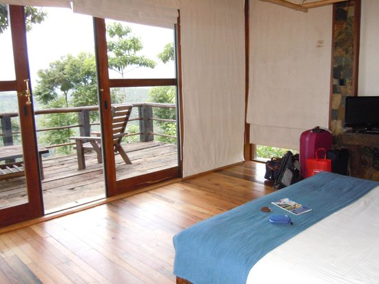98 Acres Resort and Spa:                   bedroom and verandah