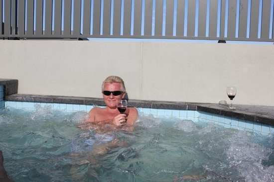 Coconut Grove Apartments:                   In the private pool upstairs