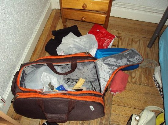 Hostal Residencia Arti:                   How my bag/room looked like after being ransacked. Drawers disheveled, bag rip