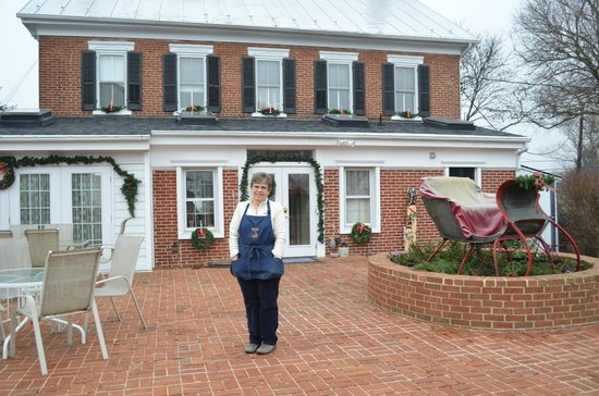 Pheasant Field Bed & Breakfast:                   Dee on her beautiful brick patio