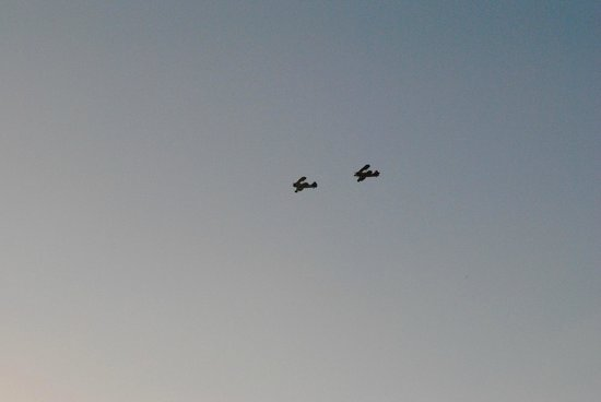two Bi-Planes flying by Mallory Square