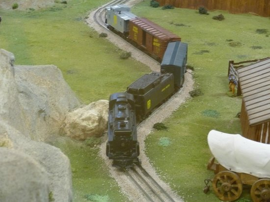 Old West Miniature Village and Museum:                                                       train; stopped on multiple curves doesn't