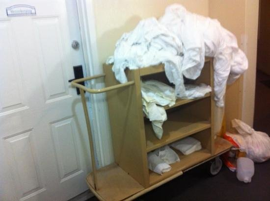 Atlantis - Harborside Resort: housekeeping cart left in hallway overnight
