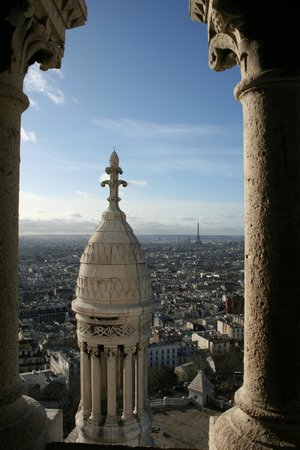 Paris-Oasis :                   Looking out across Paris from the tower of Sacre Couer