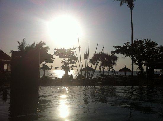 Coco Lanta Resort:                   Sun setting by pool