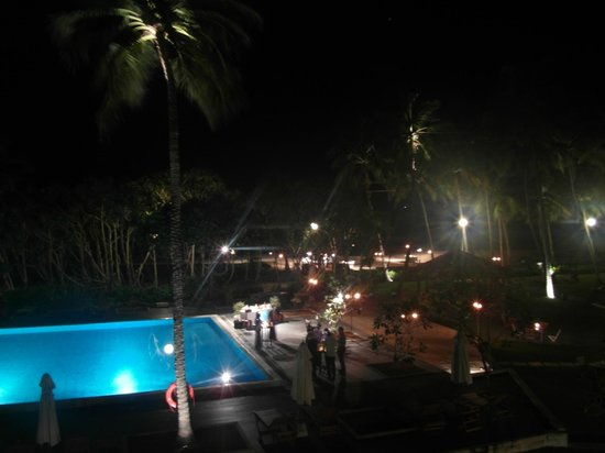 AVANI Bentota Resort & Spa:                   Evening, Set up for meal on the beach and drinks around pool.
