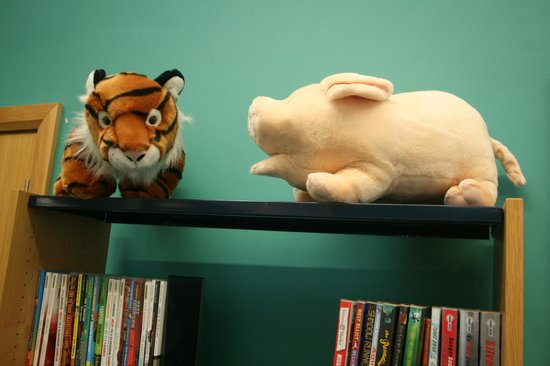 Whitehead Library: Tiger and pig, discussing literature