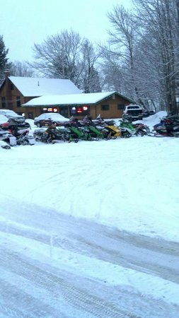 Great Pines: Snowmobiles outside Bar & Grill