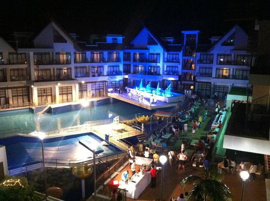Crown Regency Resort & Convention Center: night view of pool and inside of hotel