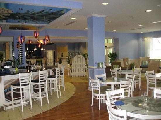 Hotel Indigo Sarasota:                   Front desk in background, bar and dining area