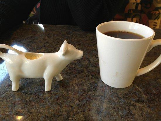 Newton's Paradise Cafe:                   Cow Creamer