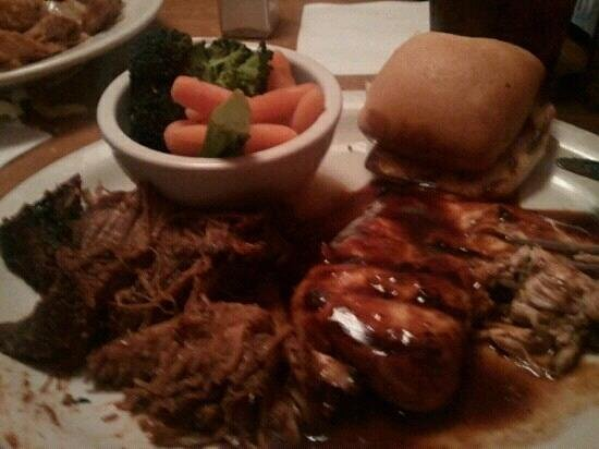 Texas Roadhouse:                   Pulled Pork with BBQ Chicken & Vegetables. It was the best I've had.