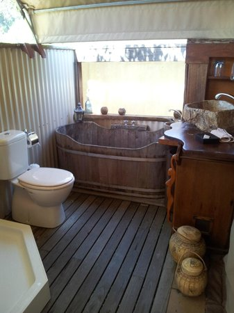 Silk Pavilions:                   Beautiful bathroom complete with wooden tub