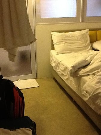 Kam Leng Hotel:                   bed then bathroom door. thats the small space between the bed and wall.