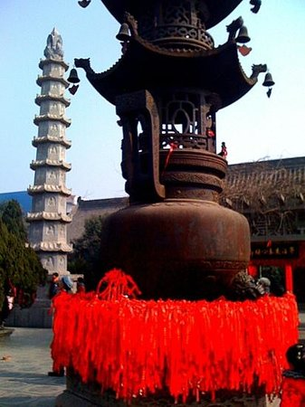 Bao Zheng's Ancestral Hall of Kaifeng:                   pilgrims ribbons  tied to temple urns for new years blessings ,Kaifeng A nn H