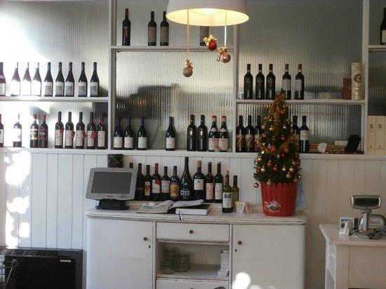 Trattoria Da Cesare: The wine display near entrance