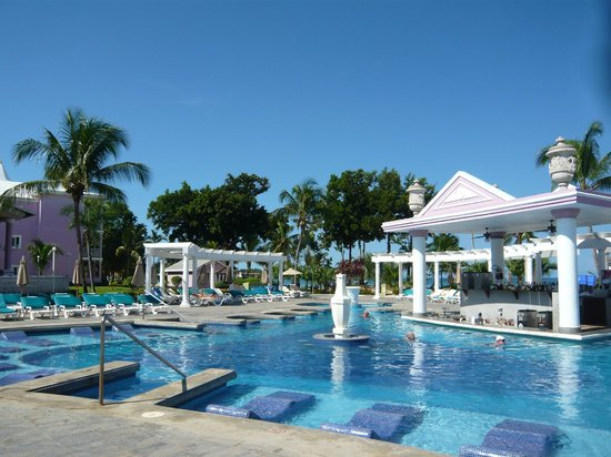 Hotel Riu Palace Tropical Bay:                   Lounge by the pool - shaded pegolas
