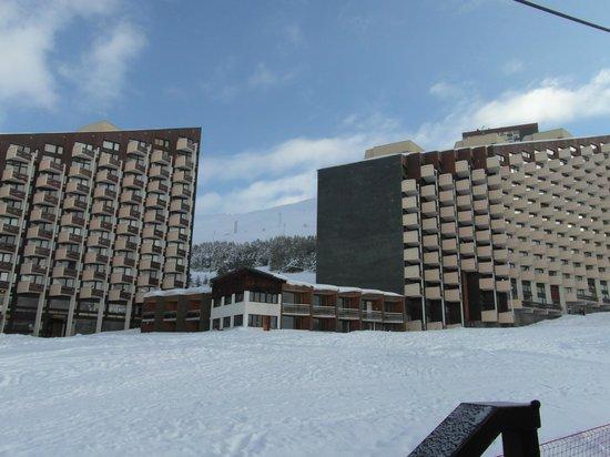 Club Hotel Les Christelles :                   Les Christelles sandwiched between 2 huge apartment blocks