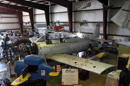 Air Heritage Museum:                                     General view of the Hangar, T-28 under work