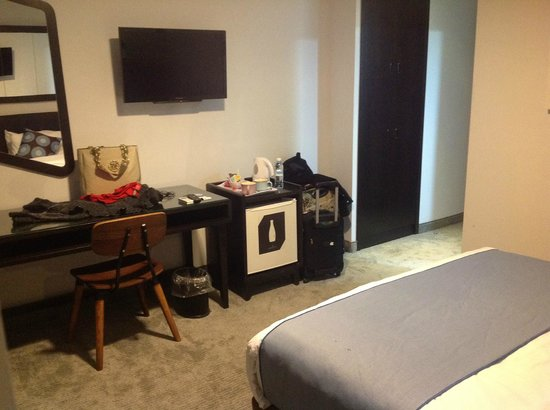 The Embassy Hotel: TV, desk and mini fridge.