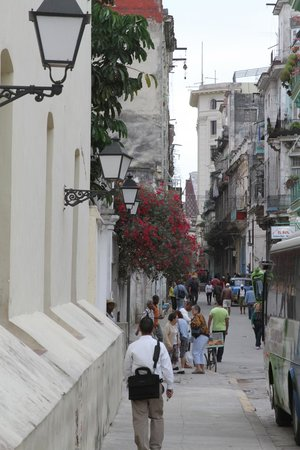 Street scenes in Old Havana are mixed with preserved and run down Spanish colonial architecture