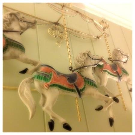 Holiday Bay Cottage Rentals:                   The Antique Carousel above our bed, so whimsical.