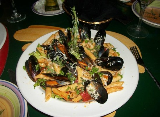 South Shore Cafe:                   Mussels in red sauce served over a bed of sauted greens and penne