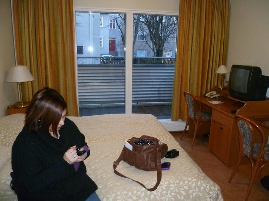 Hotel Fron:                   balcony in the far end of the room, cute tv on the right and the beds.