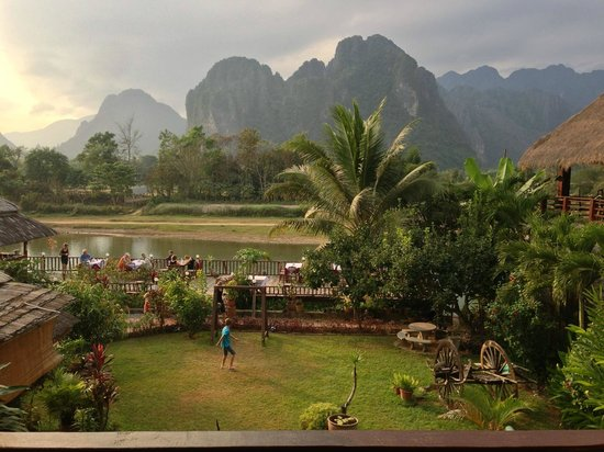 The Elephant Crossing Hotel :                   The restaurant, the river and the mountains beyond