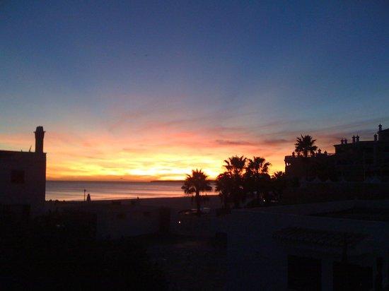 sunset over praia da rocha