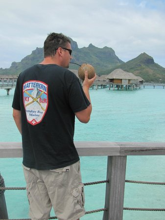 Four Seasons Resort Bora Bora:                   drinking from a coconut after breakfast, taking in the view