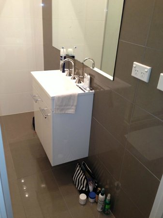 Gallery Apartments: small vanity in small bathrom