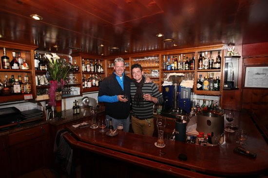 Elsie's Bar:                   Dad and I behind the bar..