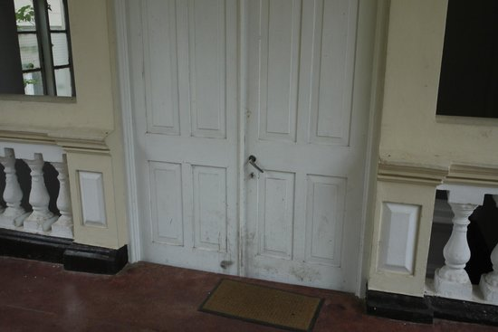 The Mansion:                   Dirty neglected rear entrance from pool