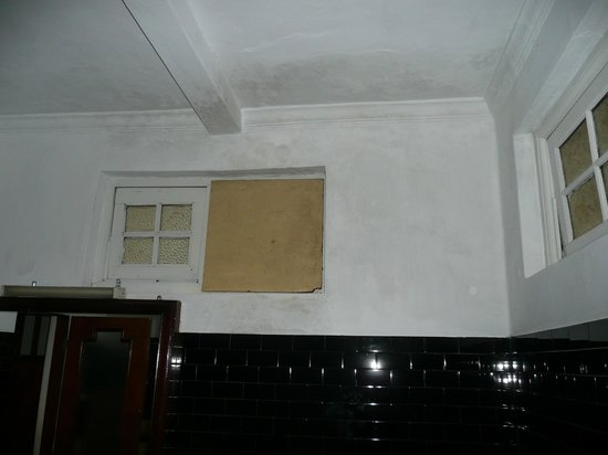 The Mansion:                   Boarded up window in mouldy dirty bathroom, room 202