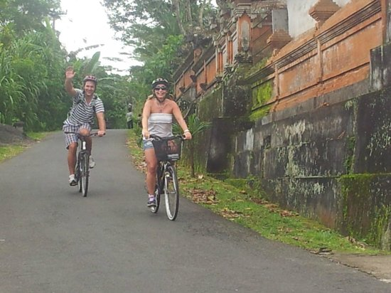We Are Family Bali Cycling Tours:                   riding through a village