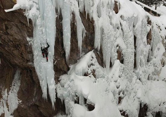 "Comfort Inn :                   Jacek Czyz of Poland climbing ""Fight  Club"" in the Ouray Ice Park"