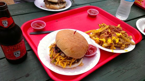 Hubcap Grill:                   Texas Bar B Que burger with cheese bacon fries and St Arnold's Santo beer!! Gr