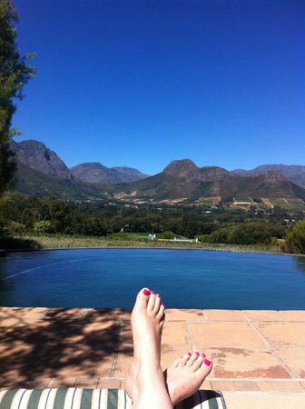 Blueberry Hill Cottages:                   View over pool to Franschhoek mountains