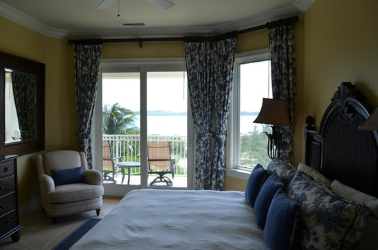 Grand Isle Resort & Spa:                   Bedroom with partial view of ocean.