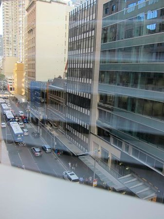 Sheraton on the Park, Sydney:                   City view room, looking on to Castlereagh st through the shutters