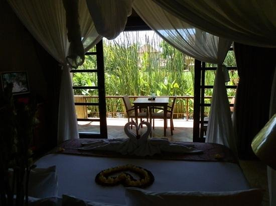 Komaneka at Monkey Forest:                   View from the room looking out on to private terrace.