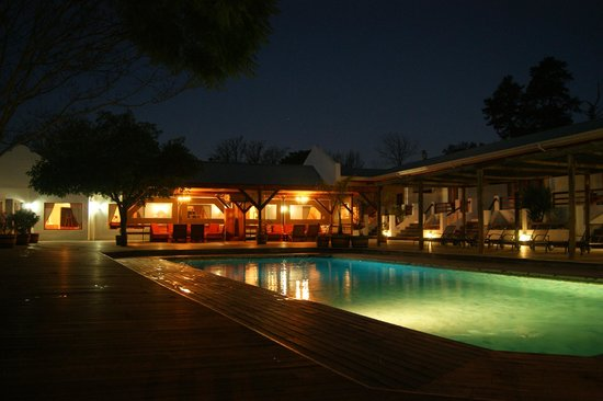 Assegaaibosch Country Lodge :                   Pool area at night
