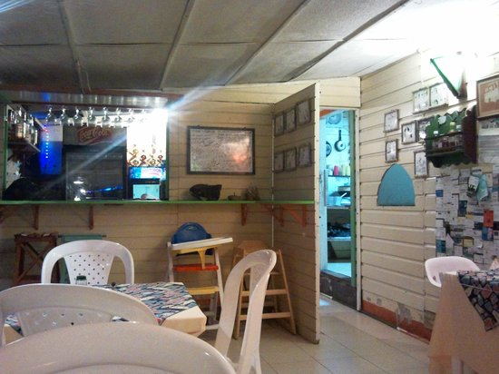 Caribbean Place Donde Martin:                   Inside tables and view to the bar