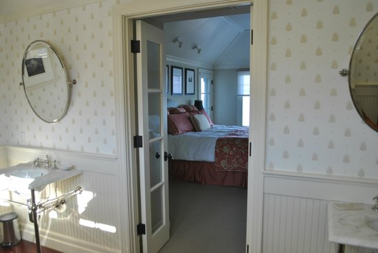 Cliff Walk Cottage on The Sea: View through Cliff Walk Suite bathroom to bedroom/ocean/Cliff Walk